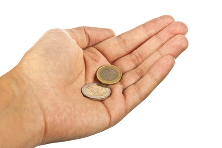 Hand with two euro coins isolated over white background photo