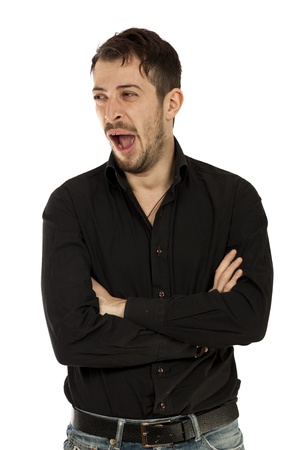 Portrait of a businessman yawning isolated over white background