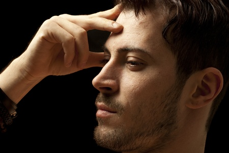 Young man thinking about a solution , isolated on black Stock Photo