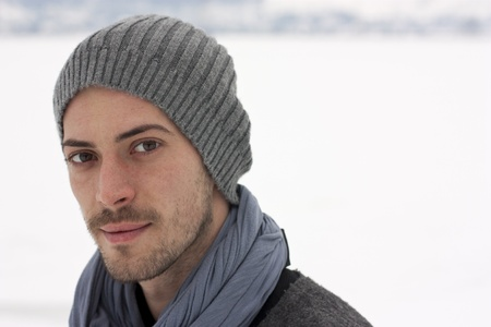 Young man in winter concentrated looks ahead  Stock Photo