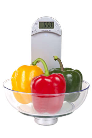 Bell peppers on a electronic kitchen scale, isolated on white background Stock Photo - 12655098