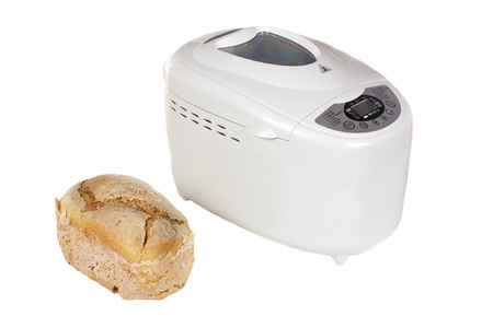 Electric bread maker and one fresh bread isolated on a white background Stock Photo