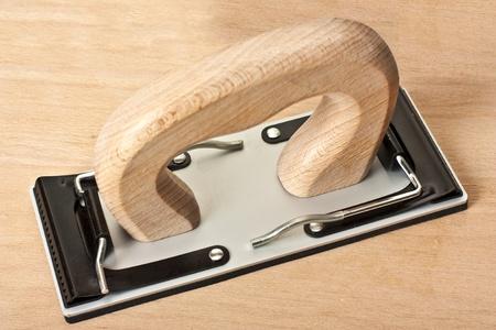 Manual sandpaper tool for home handyman use photo