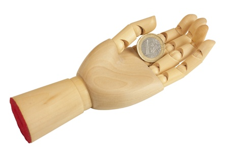 Outstretched wooden hand with one euro coin, isolated over white background  photo