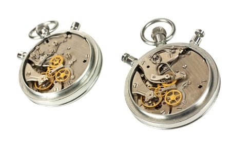 Two clock mechanisms isolated over white  photo
