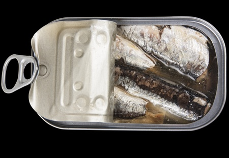 Open a can of sardines isolated on black background photo