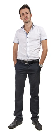 Happy young businessman standing with his hands in pockets isolated on white background