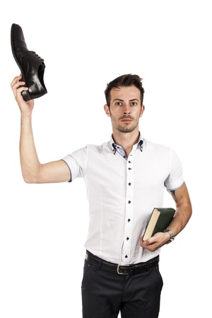 Man showing a shoe and the other hand holding a book isolated on white Stock Photo - 15369860