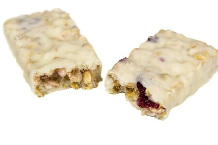 Cereal bars with cranberries, closeup shot, isolated over white photo