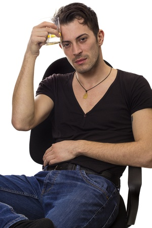 Portrait of young man with glass of cognac on his head isolated over white background photo