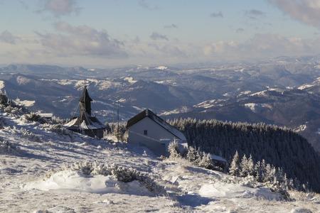 Wooden mountain church on Ceahlau Mountains in winter photo