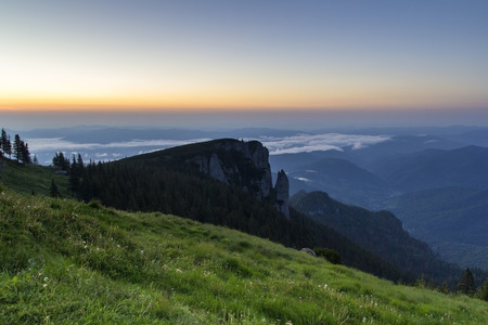 Mountain landscape from Ceahlau at sunrise in Romania photo