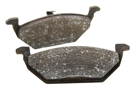 Obsolete car brake pads isolated over white background photo
