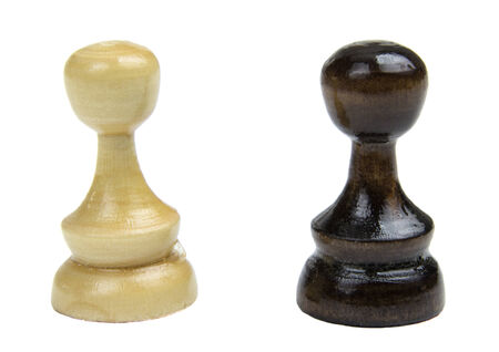 Black and white chess pieces isolated on a white background  photo