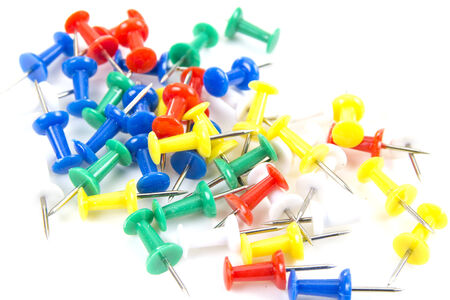 Push pins on a white background photo