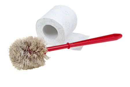 Used plastic red toilet brush and paper isolated on white background  photo