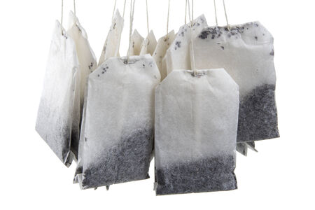 Hanging tea bags in a close-up image isolated over white background