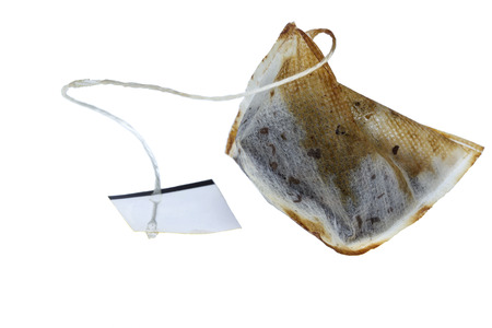 Used wet teabag  isolated on a white background photo