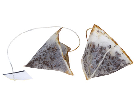 Used tea bags with isolated on white background photo