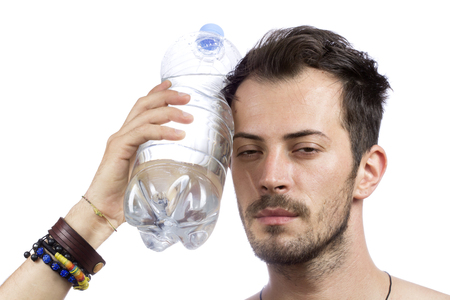 man holding a bottle of water on the face isolated over white background photo