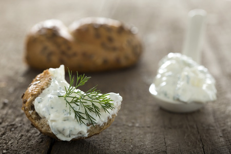 Feta cheese spread with dill on a piece  of bread Stock Photo