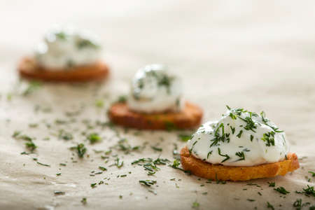 cream cheese: Fresh cream cheese spread with dill on bake rolls