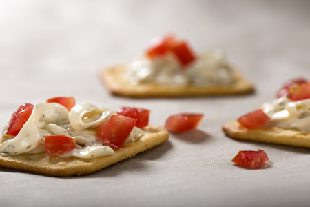 red bell pepper: Cracker with Cream Cheese and red bell pepper