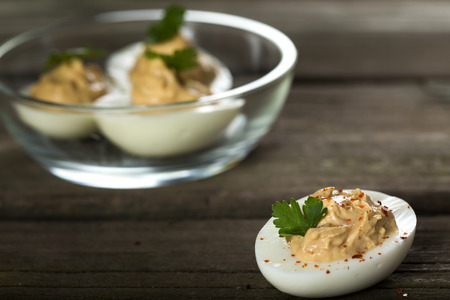 Stuffed eggs with chicken pate, red pepper and chilli Stock Photo
