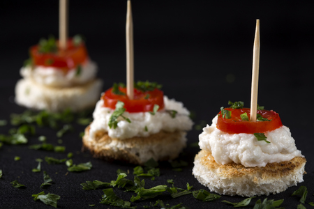 Roe salad appetizer with bread and tomatoes