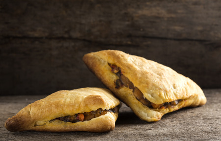 Puff pastry stuffed with mushrooms and vegetables Stock Photo