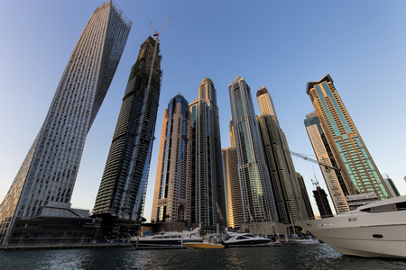persian gulf: DUBAI, UAE - NOVEMBER 21: Modern buildings in Dubai Marina, Dubai, UAE. In the city of artificial channel length of 3 kilometers along the Persian Gulf, taken on 21 November 2015 in Dubai.