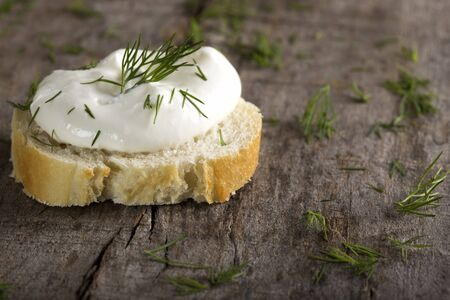 Bread with Cream Cheese over wooden background