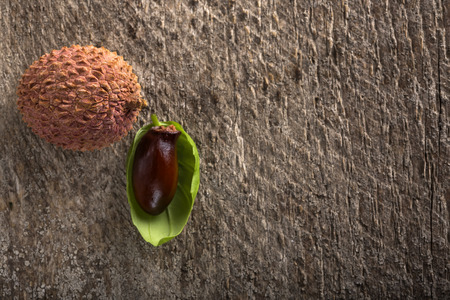 leechee: One fresh Lychee on wood table with copy space