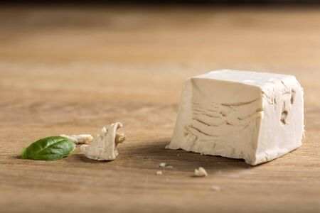 crumbled: Crumbled yeast cube on a wooden board Stock Photo