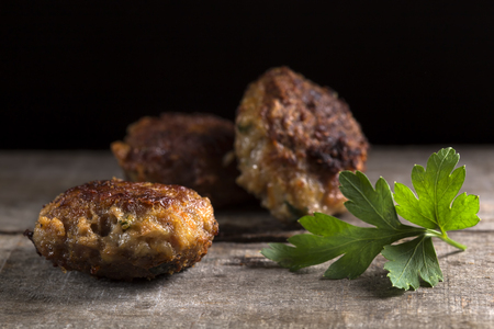 cooked pepper ball: Fresh Roasted meatballs over rustic wooden background
