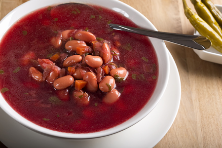 romanian: Romanian traditional beetroot soup with beans