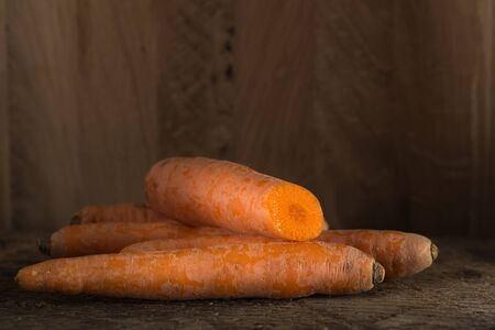 grungy: Fresh carrot bunch on grungy wooden background Stock Photo