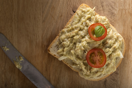 smeared: Slice of bread smeared with eggplant salad Stock Photo