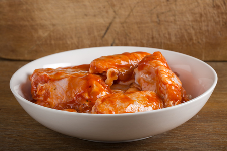 marinade: Chicken wings in the marinade sauce Stock Photo