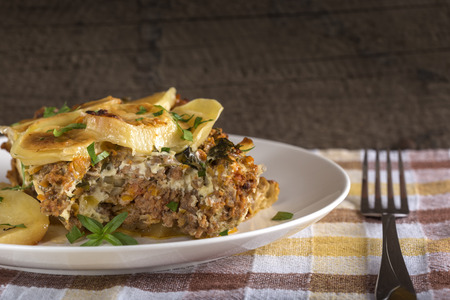 backing up: Moussaka on white plate - a traditional Greek dish Stock Photo