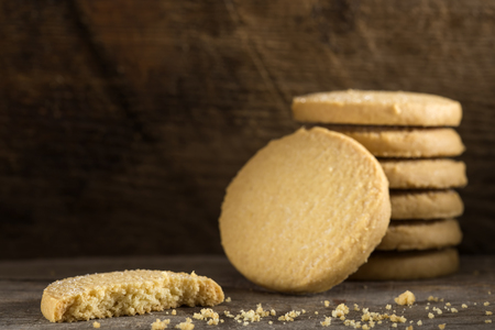 Close up of butter biscuits on old rustic wooden table Stock Photo
