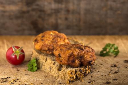 marinara sauce: Fresh chicken meatball sandwich with tomato and herbs
