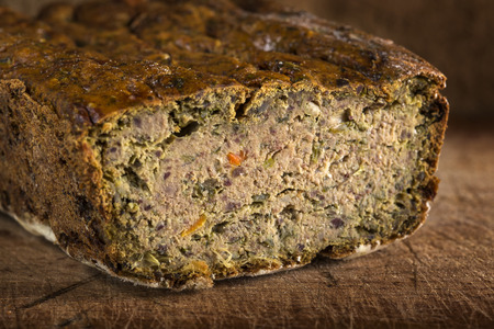 Romanian traditional food called Drob made from meatloaf on wood background