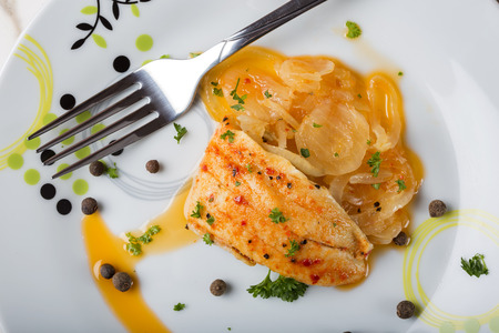 enebro: Marinated fish with onion sauce and herbs on plate Foto de archivo