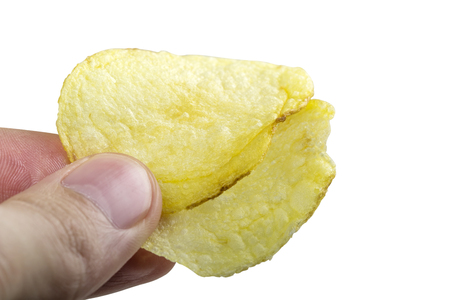 Man hand with two potato chips isolated over white background with clipping path Stock Photo