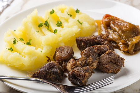 greaves: Tochitura Moldoveneasca Romanian traditional food with baked peppers