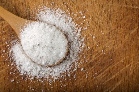 close up food: Coarse grained sea salt on wooden background