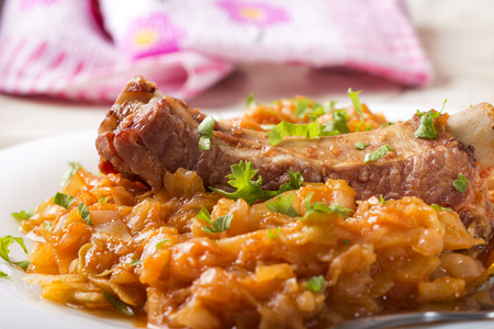 Cabbage stew with Smoked Pork Ribs and green parsley Served in white plate
