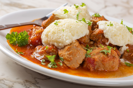 Classic goulash with dumplings, delicious heavy food, with dumplings