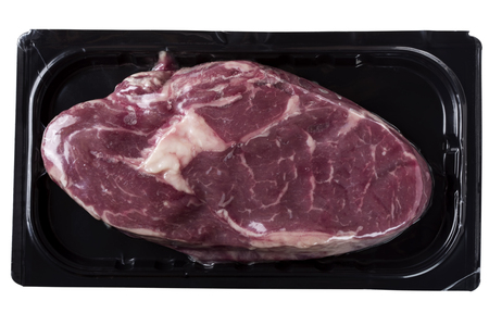 Raw rib eye steak in vacuum, isolated on white background with clipping path Stock Photo
